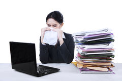Businesswoman with stack of paperwork. Stressed businesswoman working with stack of paperwork on the desk Royalty Free Stock Photos