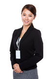 Businesswoman with staff card Stock Images