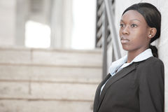 Businesswoman by a staircase Royalty Free Stock Photo