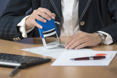 Businesswoman Stamping Document Stock Photography