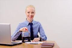 Businesswoman stamping documents Stock Images