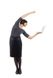 Businesswoman stand balance with laptop Stock Photography