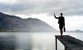 Businesswoman stand on berth Stock Photos