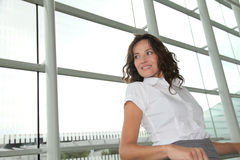 Businesswoman standing in airport Royalty Free Stock Image