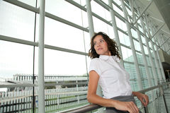 Businesswoman standing in airport Stock Image