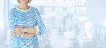 Businesswoman standing alone on a blue background. Businesswoman standing on a blue background Royalty Free Stock Photos