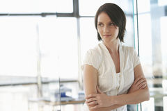 Businesswoman Standing Arms Crossed In Office Stock Photos