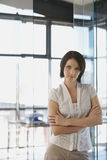 Businesswoman Standing Arms Crossed In Office Royalty Free Stock Photography