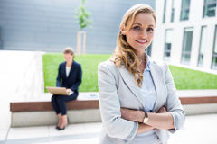 Businesswoman standing with arms crossed in office premises. Portrait of businesswoman standing with arms crossed in office premises Stock Photos