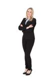 Businesswoman standing arms crossed over white background Royalty Free Stock Images