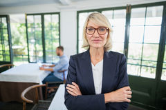 Businesswoman standing with arms crossed in a restaurant Royalty Free Stock Photography