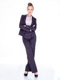 Businesswoman Standing with Arms Crossed in Studio Stock Images