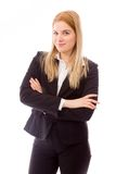 Businesswoman standing with arms crossed Stock Images