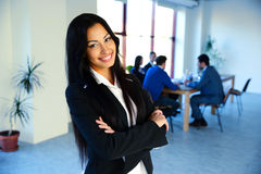 Businesswoman standing with arms folded Royalty Free Stock Image