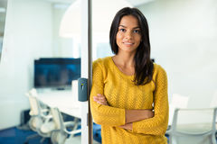 Businesswoman standing with arms folded Stock Image
