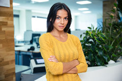 Businesswoman standing with arms folded Stock Images