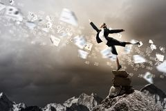 Businesswoman standing atop of mountain Royalty Free Stock Images