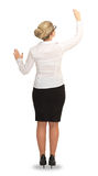 Businesswoman standing with back drawing business ideas on wall Stock Images