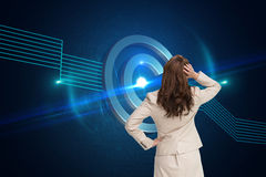 Businesswoman standing back to camera with hand on head royalty free stock photo