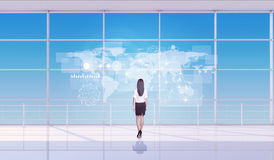 Businesswoman standing back with virtual map Royalty Free Stock Image
