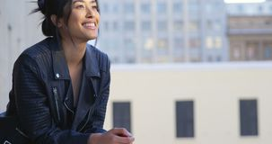 Businesswoman standing in balcony at office 4k stock video footage
