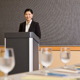 Businesswoman Standing Behind Podium Royalty Free Stock Photography