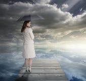 Businesswoman standing on bridge Stock Photos