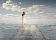 Businesswoman standing on a bridge Royalty Free Stock Photography