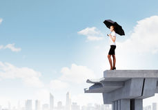 Businesswoman standing on bridge Royalty Free Stock Image