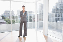 Businesswoman standing in bright office Stock Photos