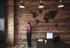 Businesswoman standing chatting on her mobile stock images