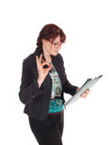 Businesswoman standing with clipboard. Stock Photography