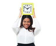 Businesswoman standing with clock on head. Happy afro american businesswoman standing with clock on head isolated on a white background. Looking at camera Stock Images