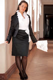 Businesswoman standing in corridor Stock Images