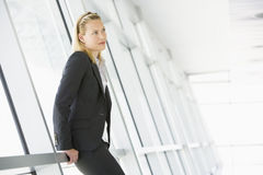 Businesswoman standing in corridor Stock Photo