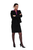 Businesswoman standing cross-armed Stock Photos