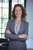 Businesswoman standing with crossed arms. In a restaurant Royalty Free Stock Images