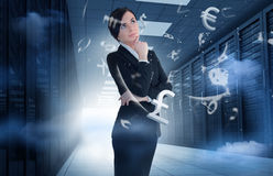 Businesswoman standing in data center with currency graphics Stock Photos