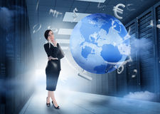 Businesswoman standing in data center with earth and currency gr. Businesswoman standing and thinking in data center with earth and currency graphics Royalty Free Stock Image