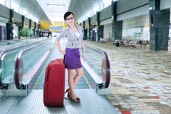 Businesswoman standing on escalator 2 Royalty Free Stock Image
