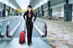 Businesswoman standing on escalator 1 Royalty Free Stock Images