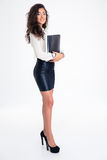 Businesswoman standing with folder Stock Image