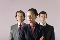 Businesswoman Standing In Front Of Businessmen Stock Images