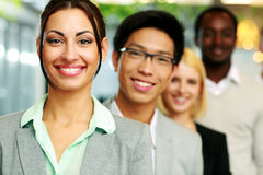 Businesswoman standing in front of colleagues Stock Image