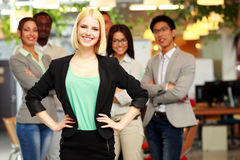 Businesswoman standing in front of colleagues Royalty Free Stock Photography