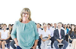 Businesswoman Standing in Front of the Crowd Stock Image