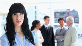 Businesswoman standing in front of her work team Stock Images