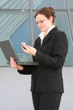 Businesswoman standing in front of office building Stock Photography