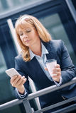 Businesswoman standing in front of an office building Stock Photos