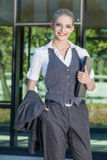 Businesswoman standing at front of office building Royalty Free Stock Image